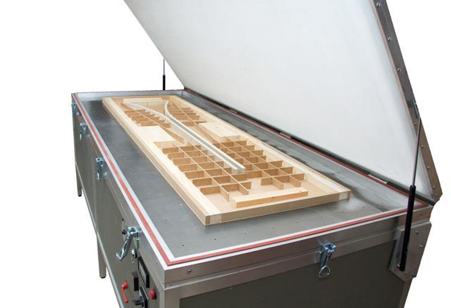 Вакуумный пресс: назначение оборудования и его конструкция, критерии выбора техники, сферы применения